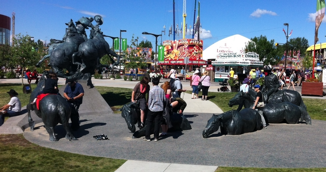 """By the banks of the Bow"" is a massive bronze sculpture that serves as a great meeting place.  It is a popular photo spot and also a wonderful work of art that enhances the sense of place at Stampede Park."