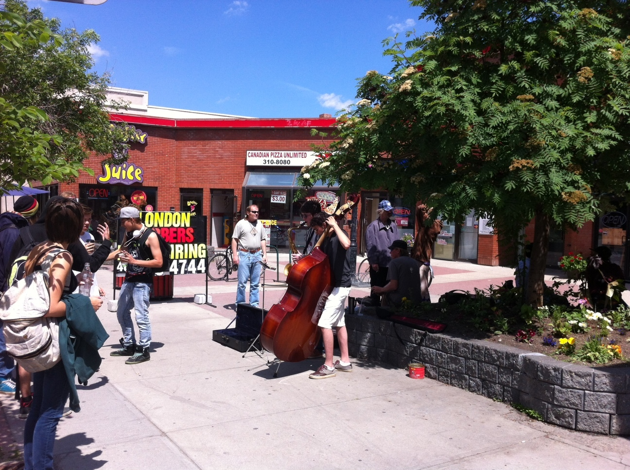 Kensington's 10th Street Plaza next to Roasterie is a popular busking spot.