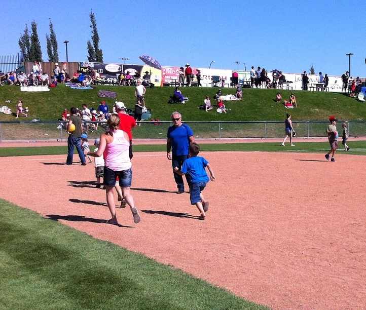 A future Dawg and his Mom practice running the bases.