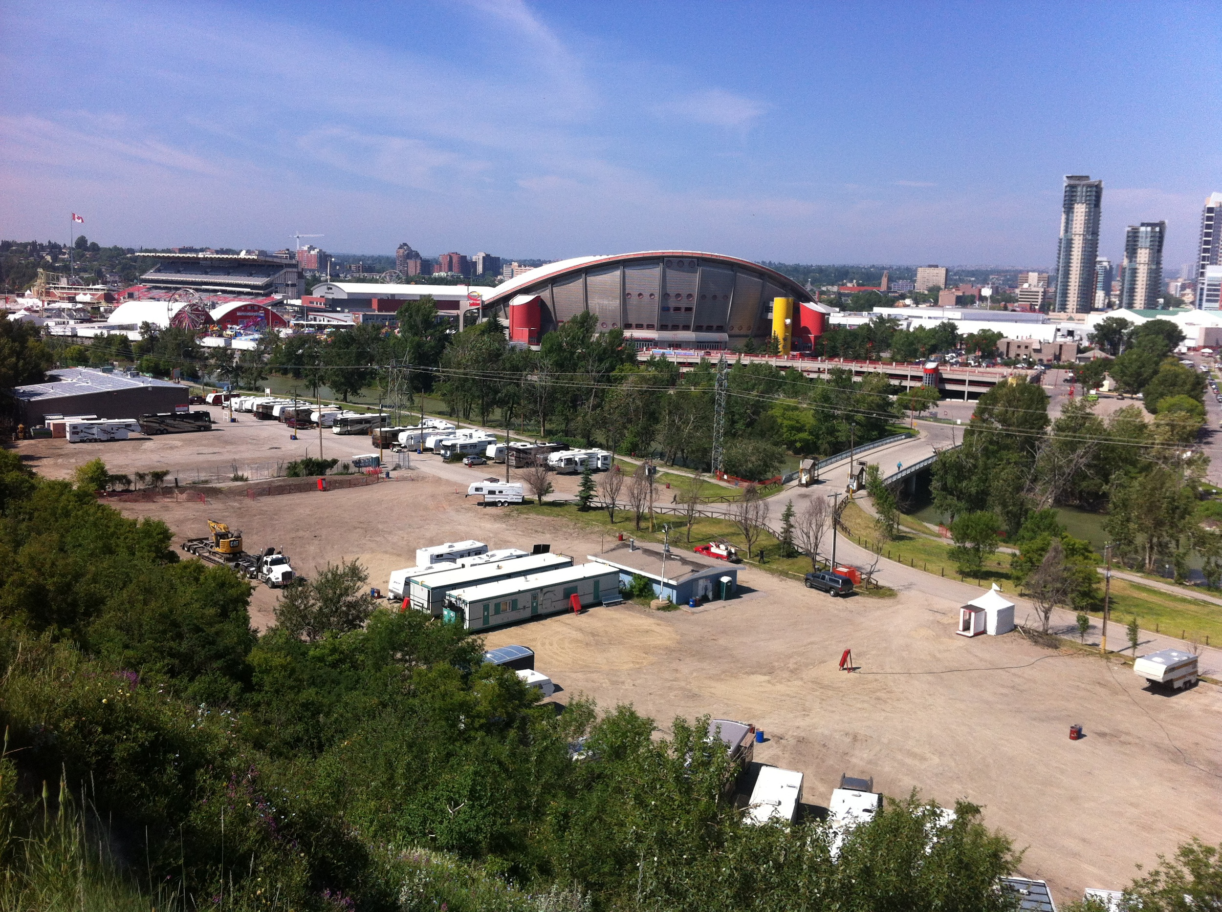 The site of the new ENMAX Park at Stampede next to the Elbow River. Putting the park back into parking lots.