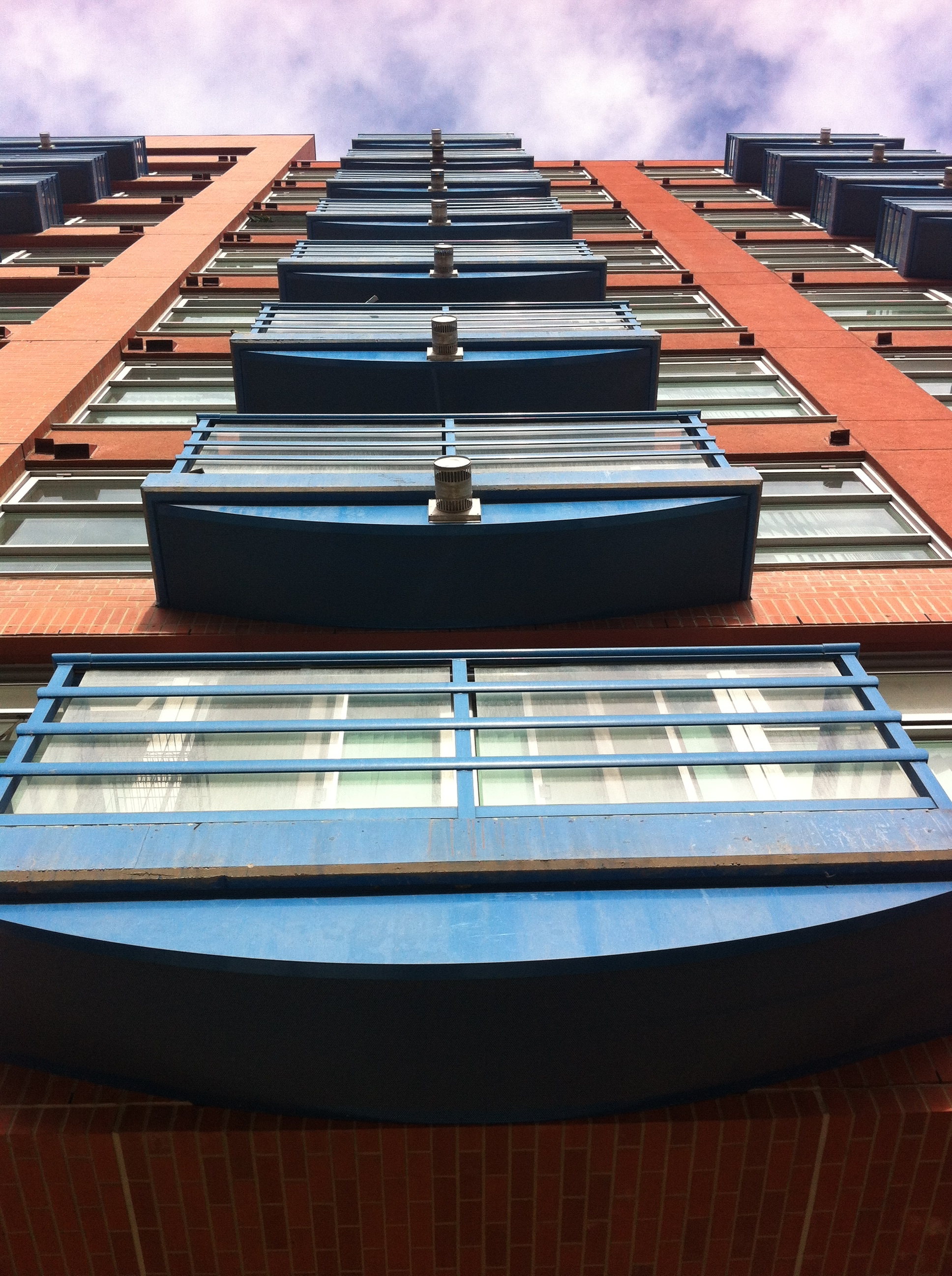 Blue balconies lead the eye to the blue sky.