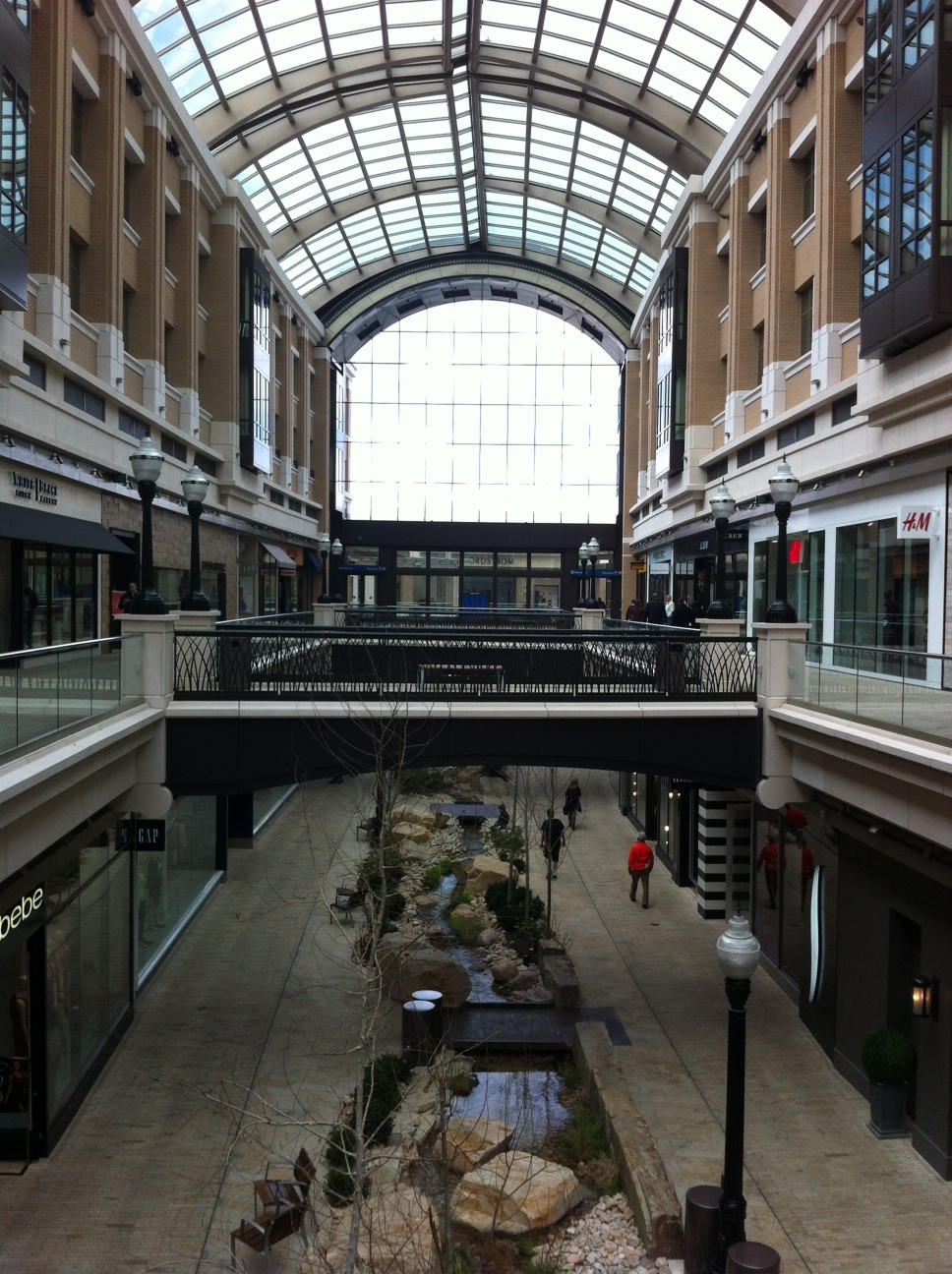 SLC's City Creek shopping centre does indeed have a creek running through it that meanders back outside.