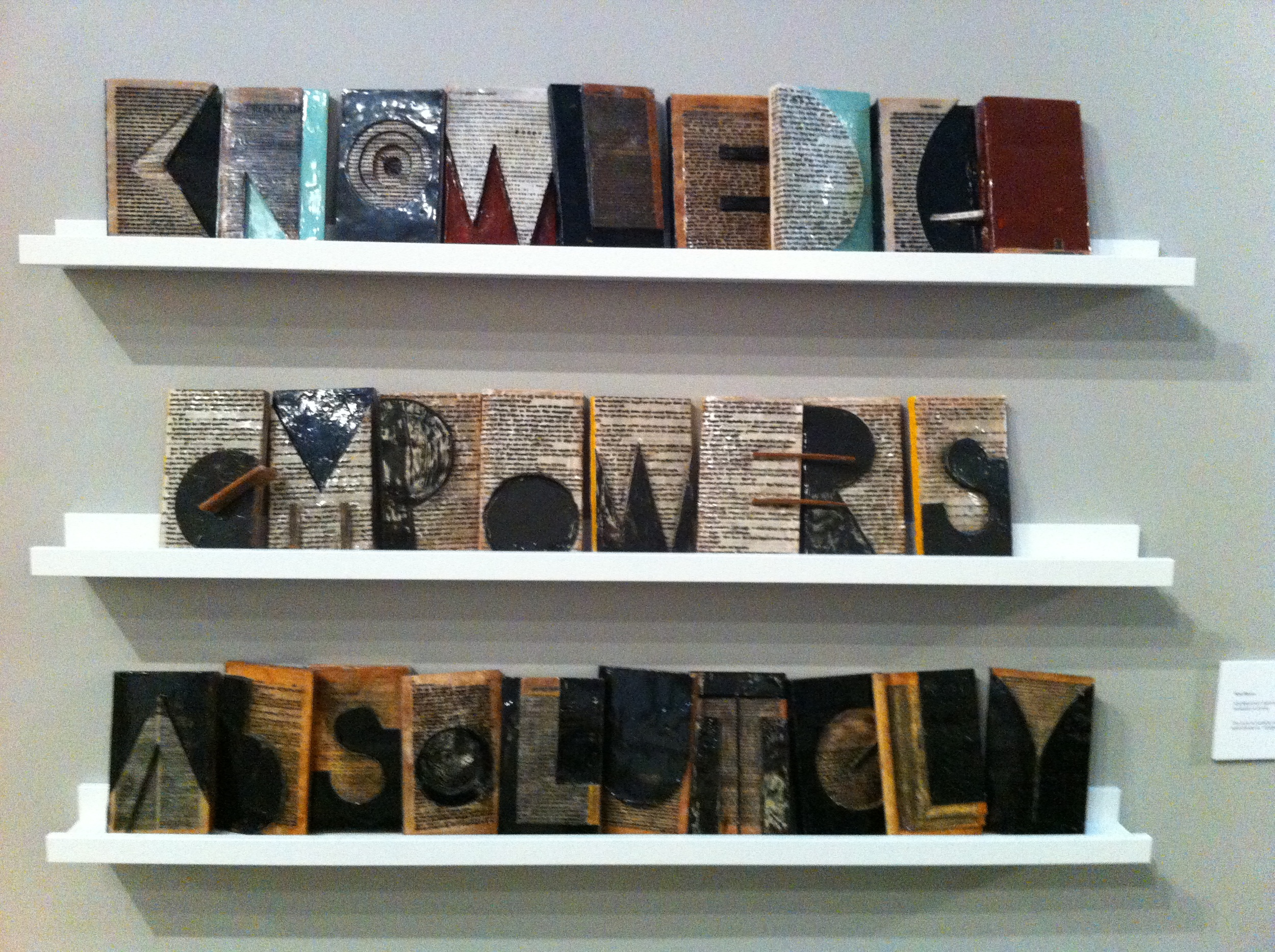 "Kim Bruce, ""KNOWLEGE EMPOWERS ABSOLUTELY,"" encaustc on books, 48""Wx 33""H x 4""D"