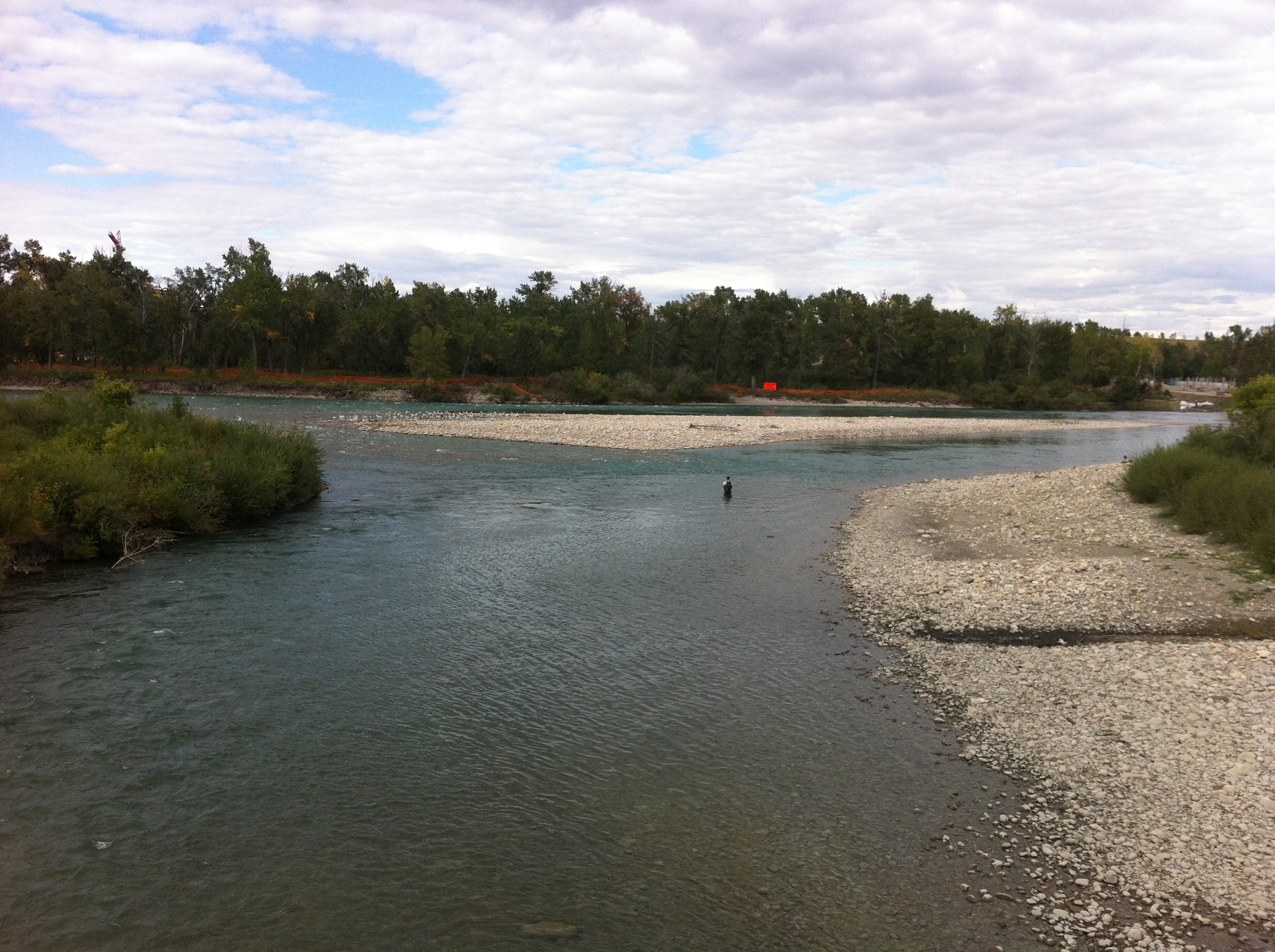 Fly fisherman at the confluence of the Elbow and Bow Rivers near the northeast edge of Fort Calgary.