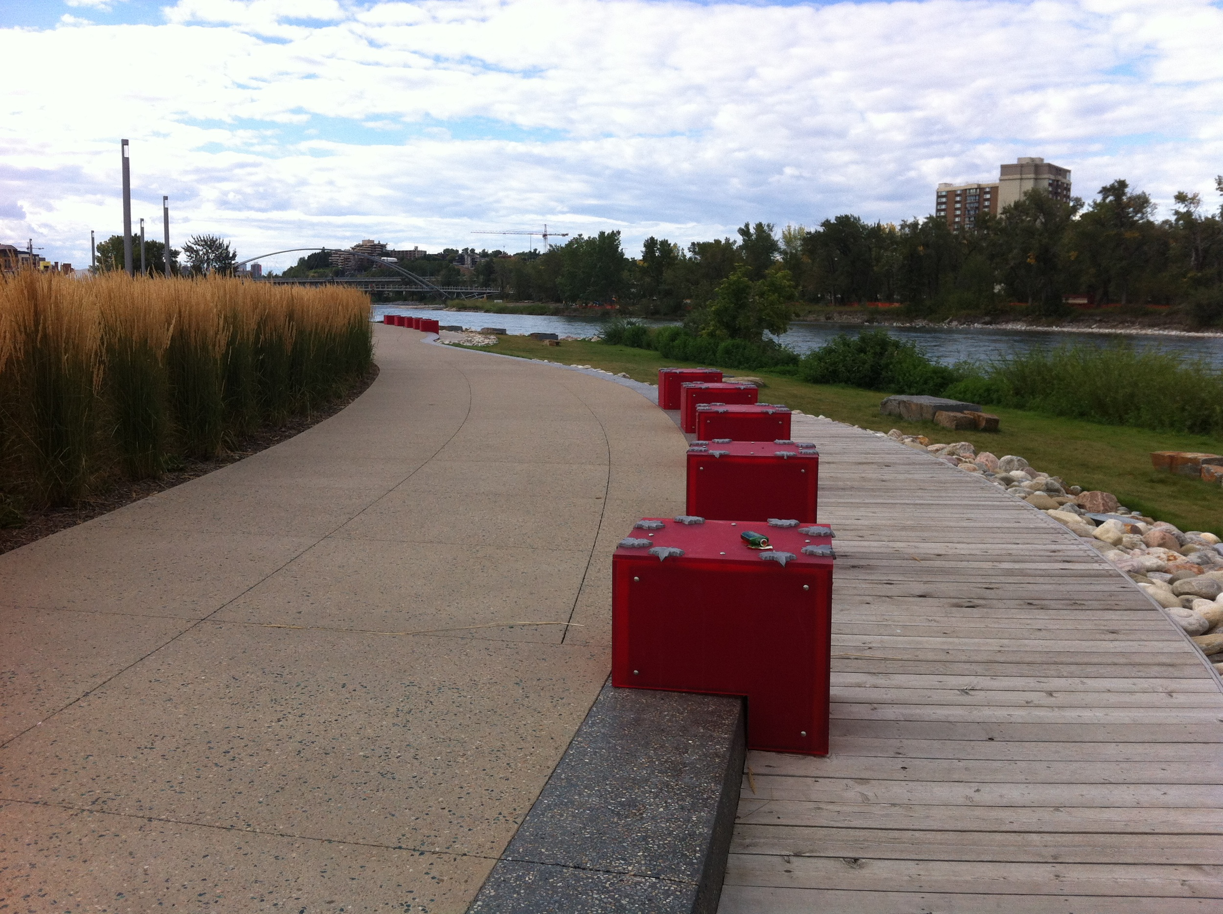 Bow River promenade at Fort Calgary with the new St. Patrick's Island bridge in the background. This will become a very busy area with the densification of the surrounding residential neighbourhoods.