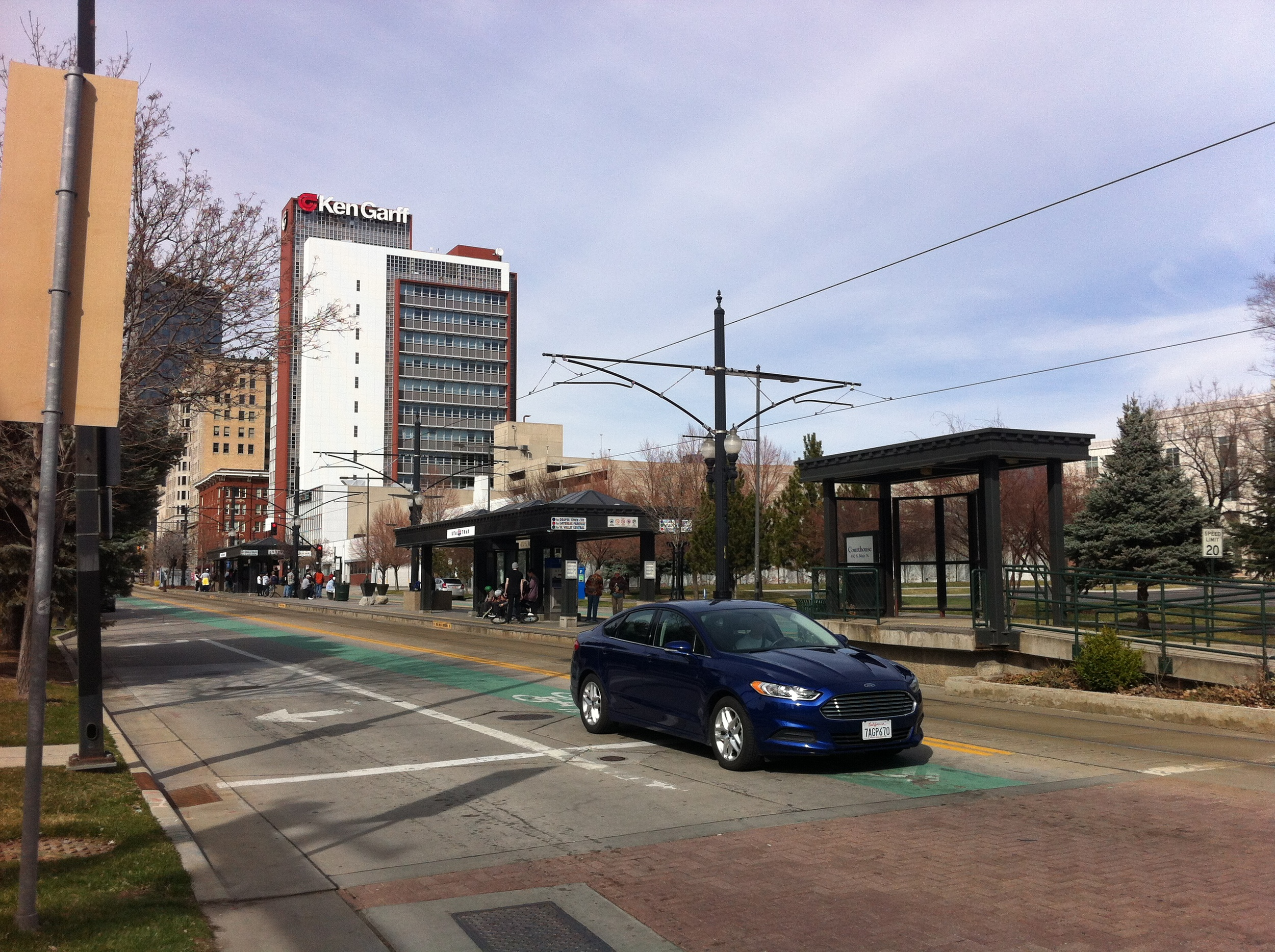 Salt Lake City allows cars, LRT and cyclist to share the road.