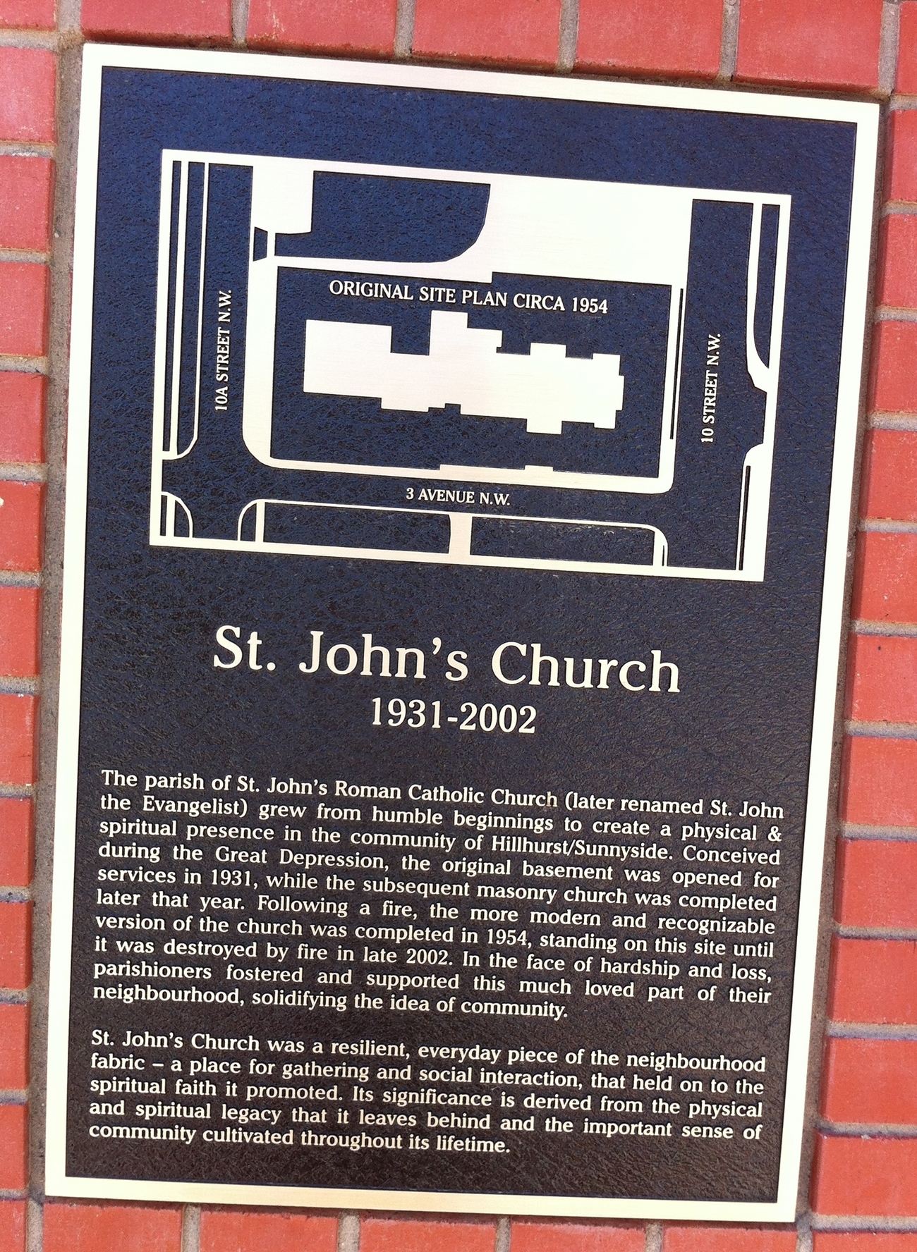Plaque on the side of St. John's condo documenting a bit of the history of the site.