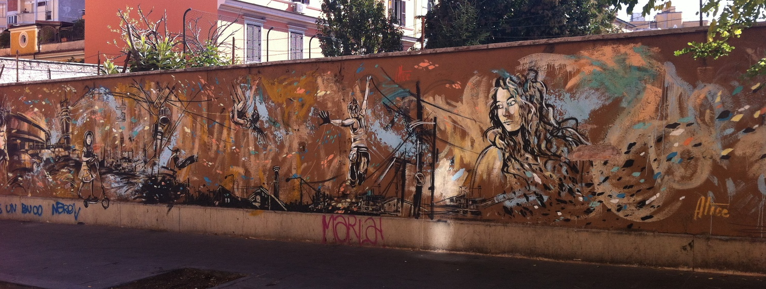 The second side of street art wall is devoted to the work of one artist.