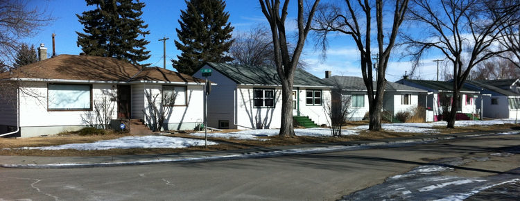 A street of older mid-century homes in one of Calgary's established communities on 50 foot lots. Typically they sell for $500+ to developers who knock them down and build a two story infill that is 1,800+ sf and better meets the needs of a modern family.