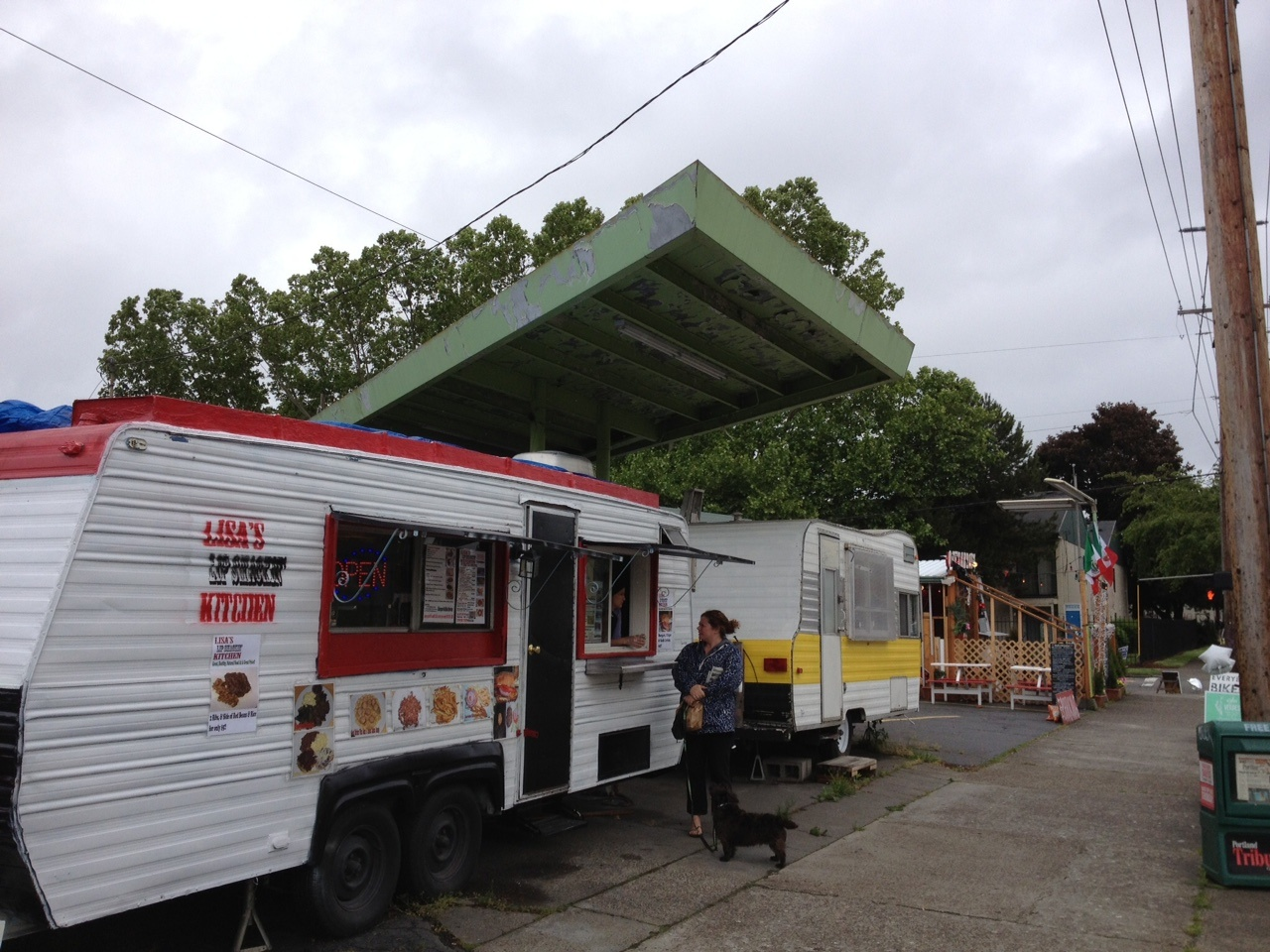 Urban living is about living on the streets?  Food carts in Portland's suburbs encourage street dining.