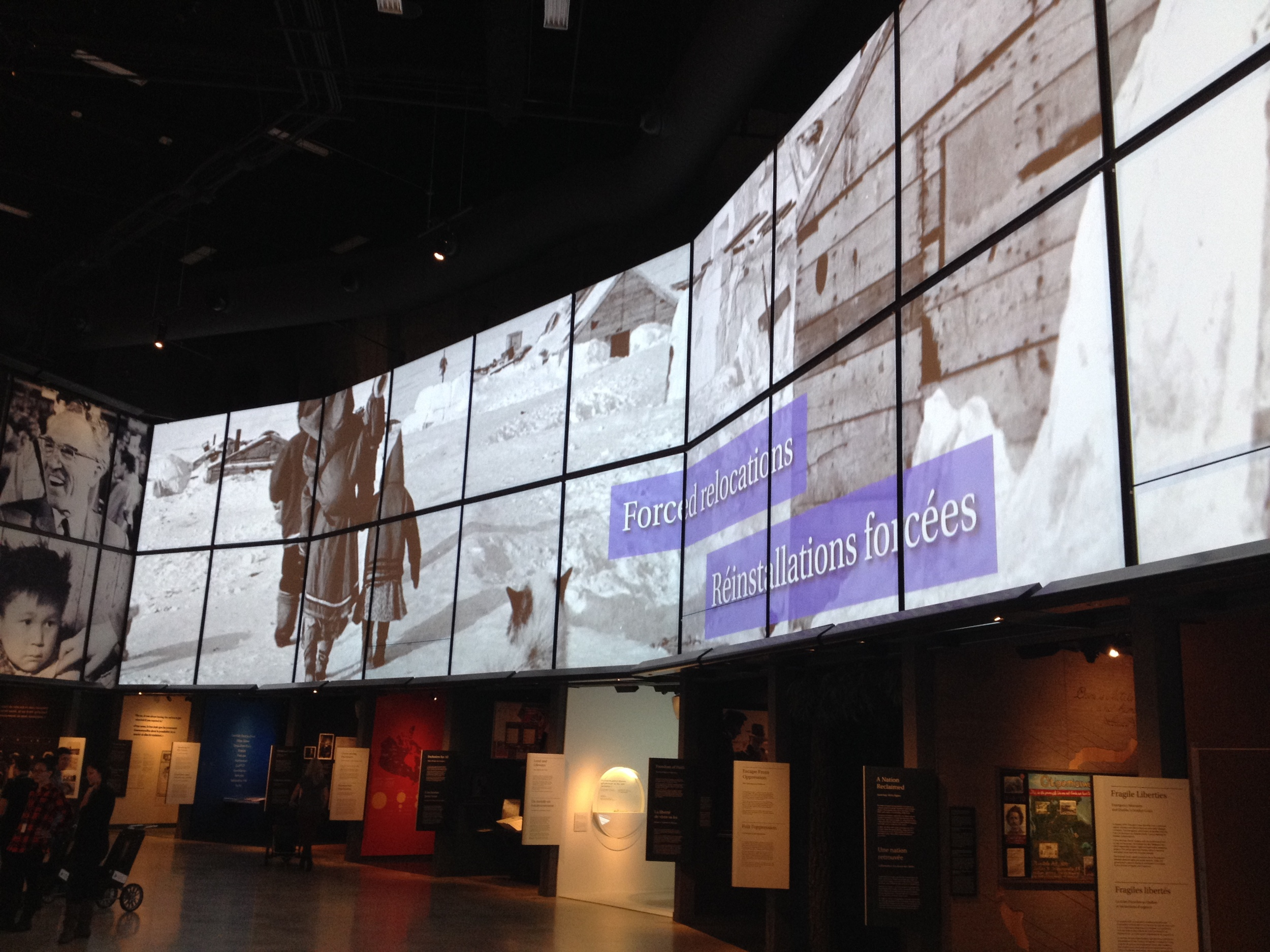 Several of the exhibition halls are dominated by a large billboard like video screen with words and images.