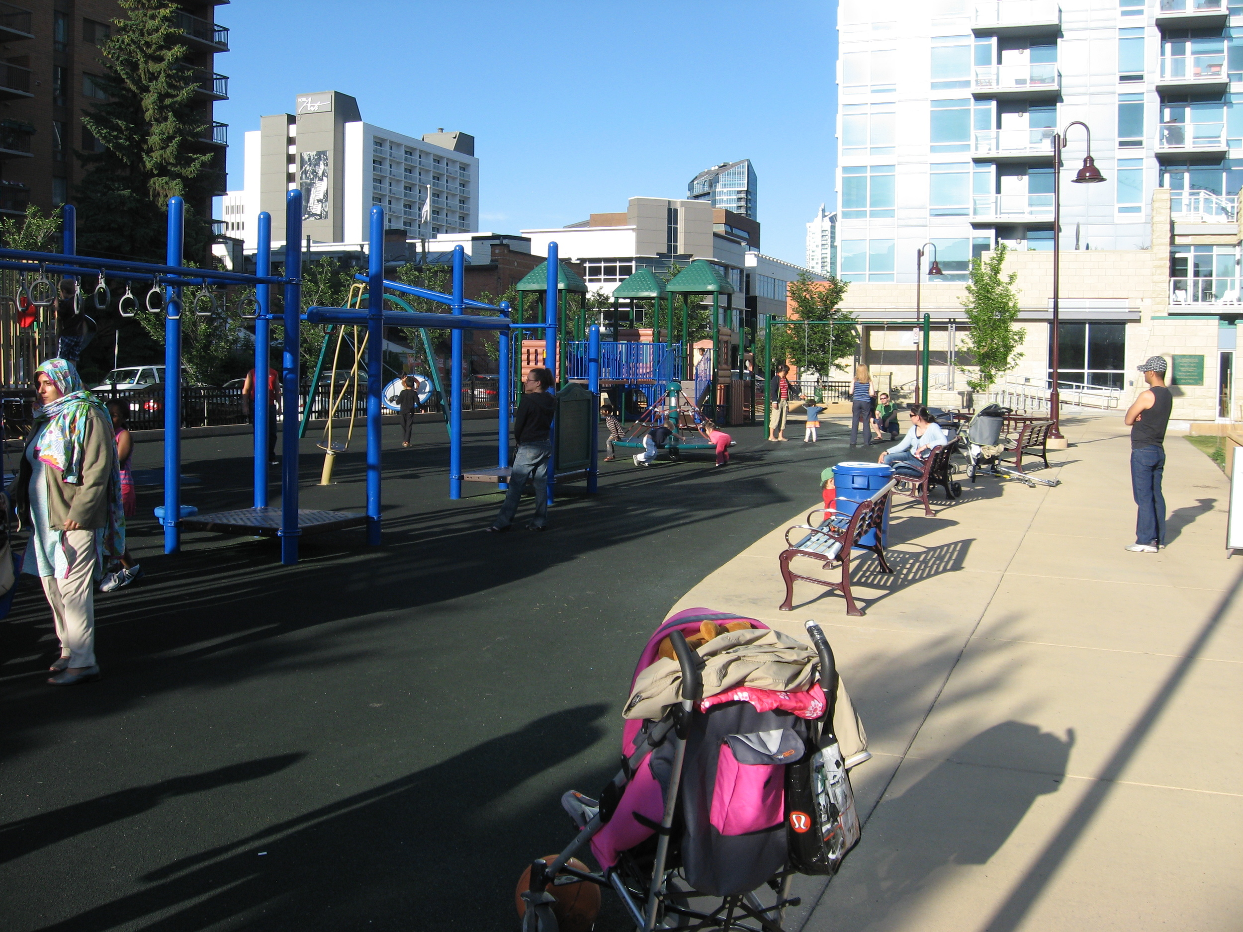 Who says Calgary's City Centre isn't for families? The Beltline's Haultain Park is full of families using the playground, tennis courts and the playing field for a pick-up game of soccer.