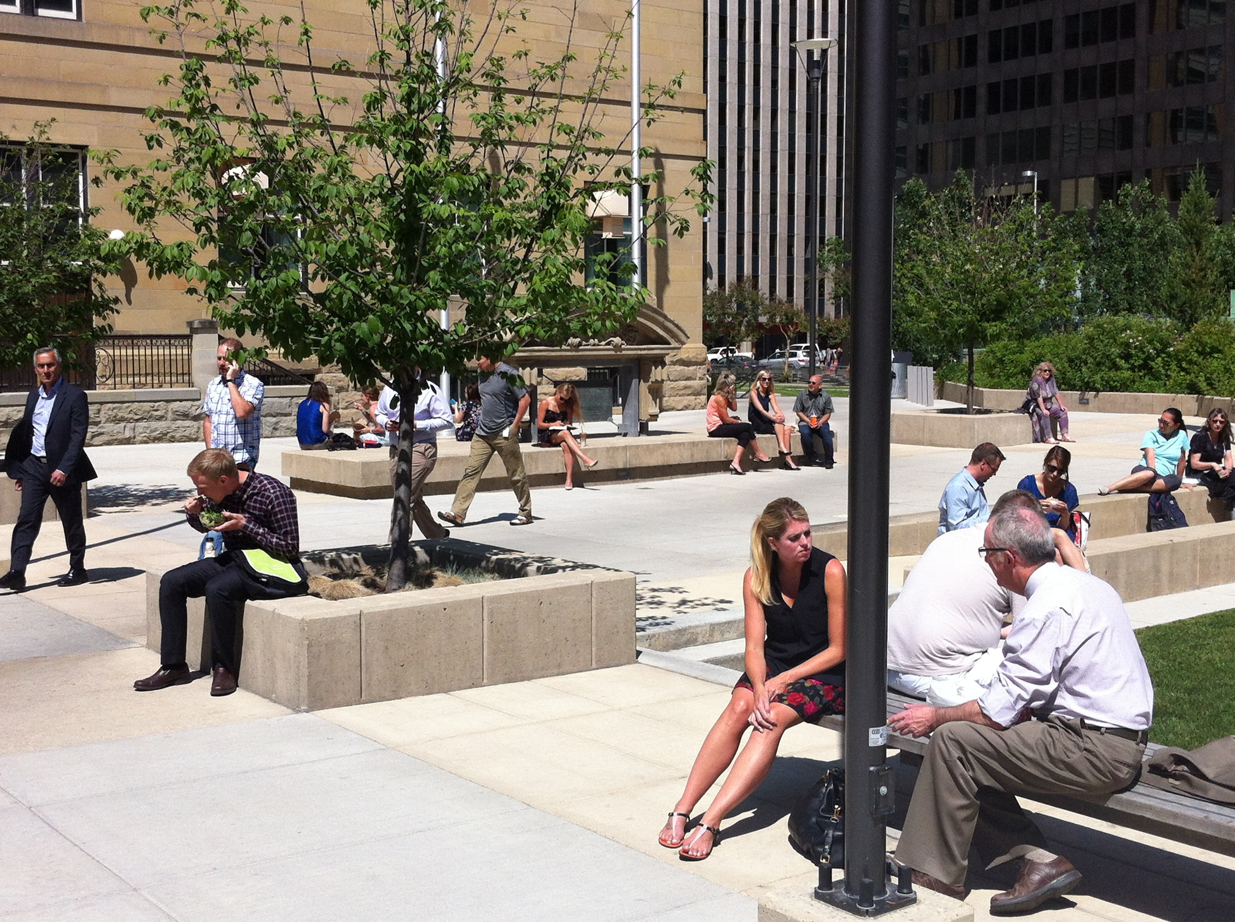 The Harley Hotchkiss Gardens is a popular meeting spot for downtown workers and shoppers. This public space is a good example of go urban design as it is built on top of a 700-stall parking garage, includes a major public artwork, has lots of seating and is directly linked to an LRT station.