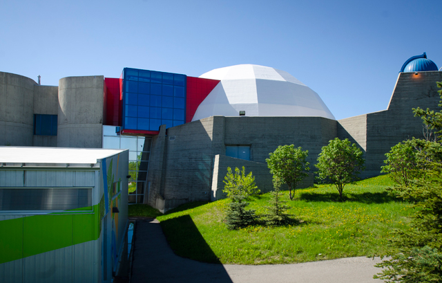 Centennial Planetarium as seen from the Bow River pathway.