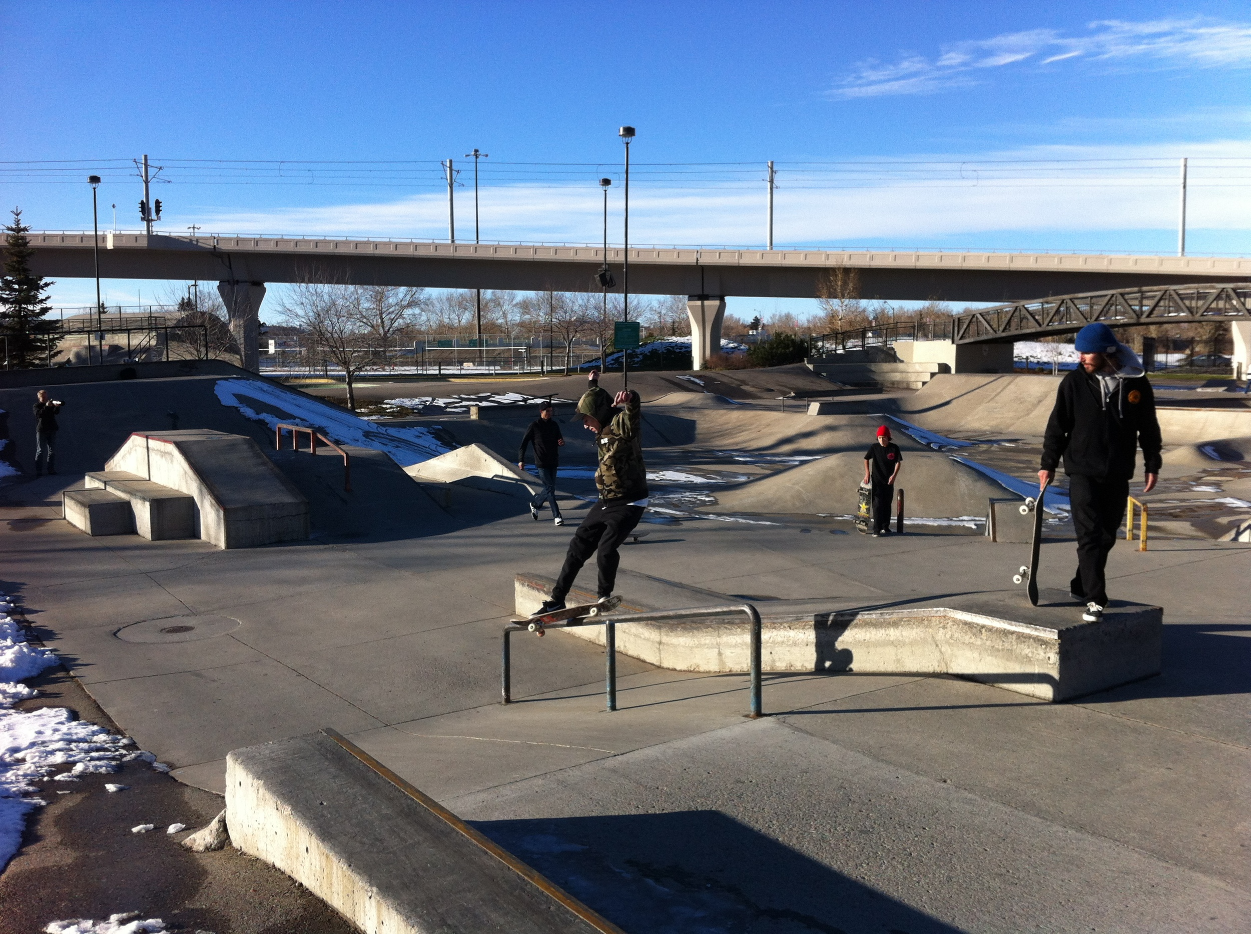 Next to the Centennial Planetarium is Shaw Millennium Park, one of the world's largest skateparks. The design of the Park with its concrete jumps, bowls and other forms is very synergistic to Long's brutalist design. In the background is the concrete West LRT bridge which enters and exits the downtown at the Planetarium, making it a dramatic gateway.