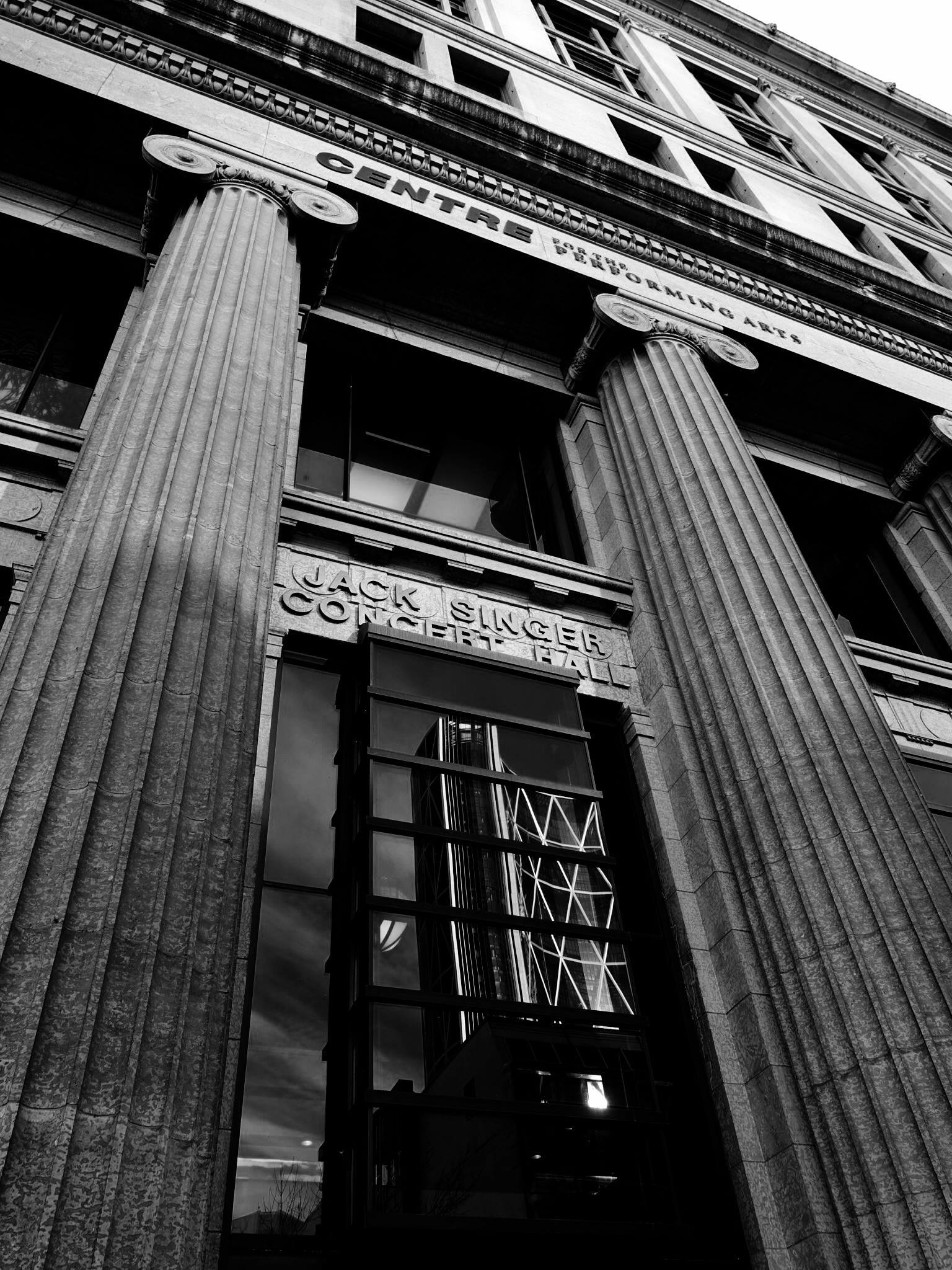 The juxtaposition of the Bow Tower in the pillars of the historic Public Building was barely visible in the colour images. In b&w the texture and pattern in the columns is revealed.