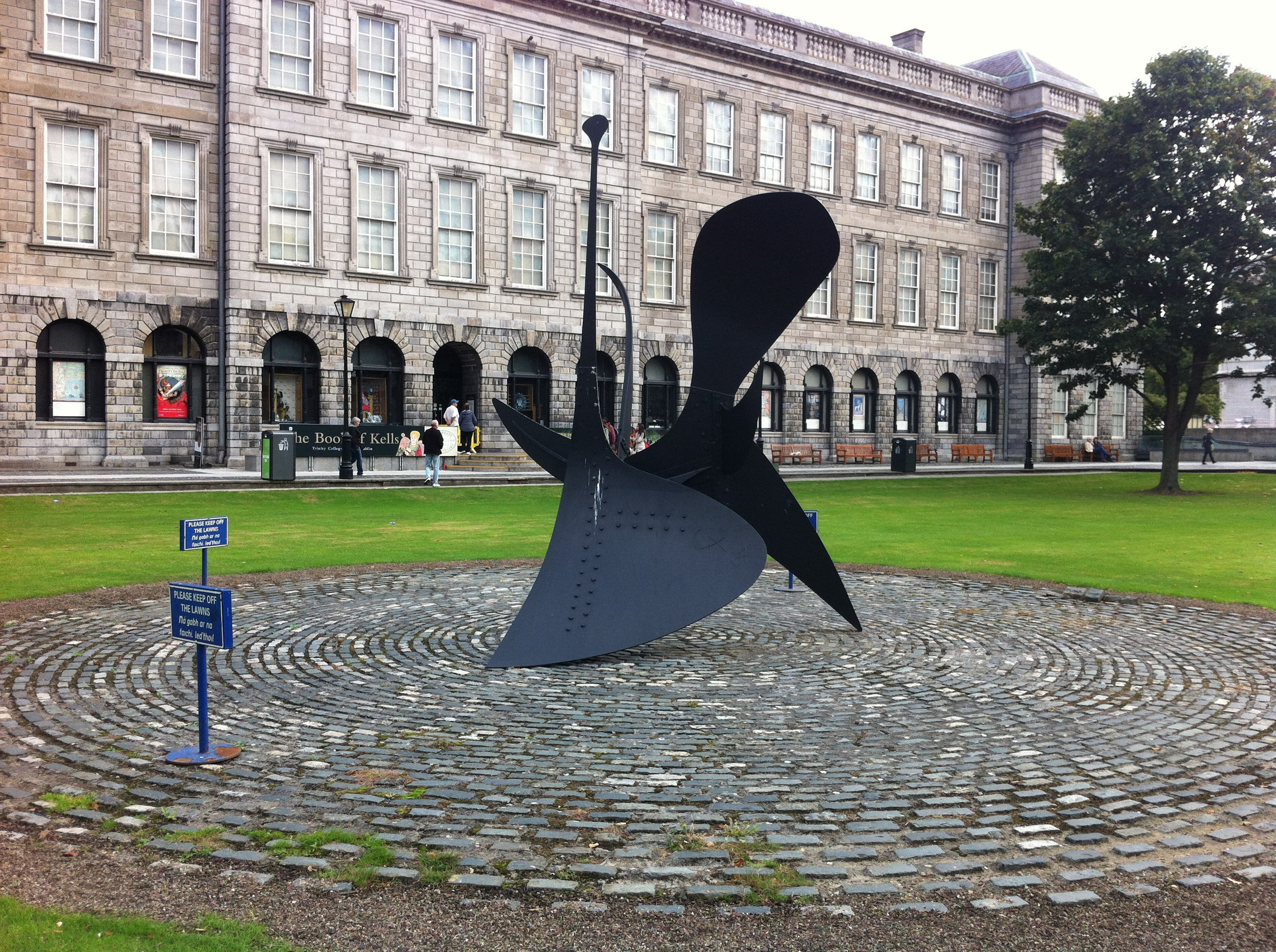 """This Trinity College signsays """"Keep Off."""" Seems strange to have a piece of public art out in the open like this and not encourage people to have a closer look."""