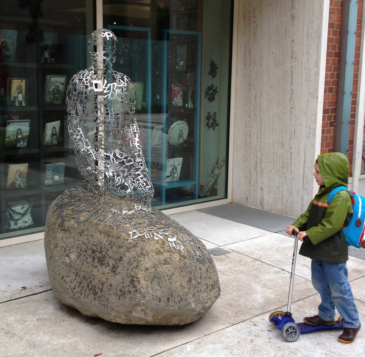 This little guy seems to be quite intrigued by the ghost-like figure made up of letters from different languages by Jaume Plensa.