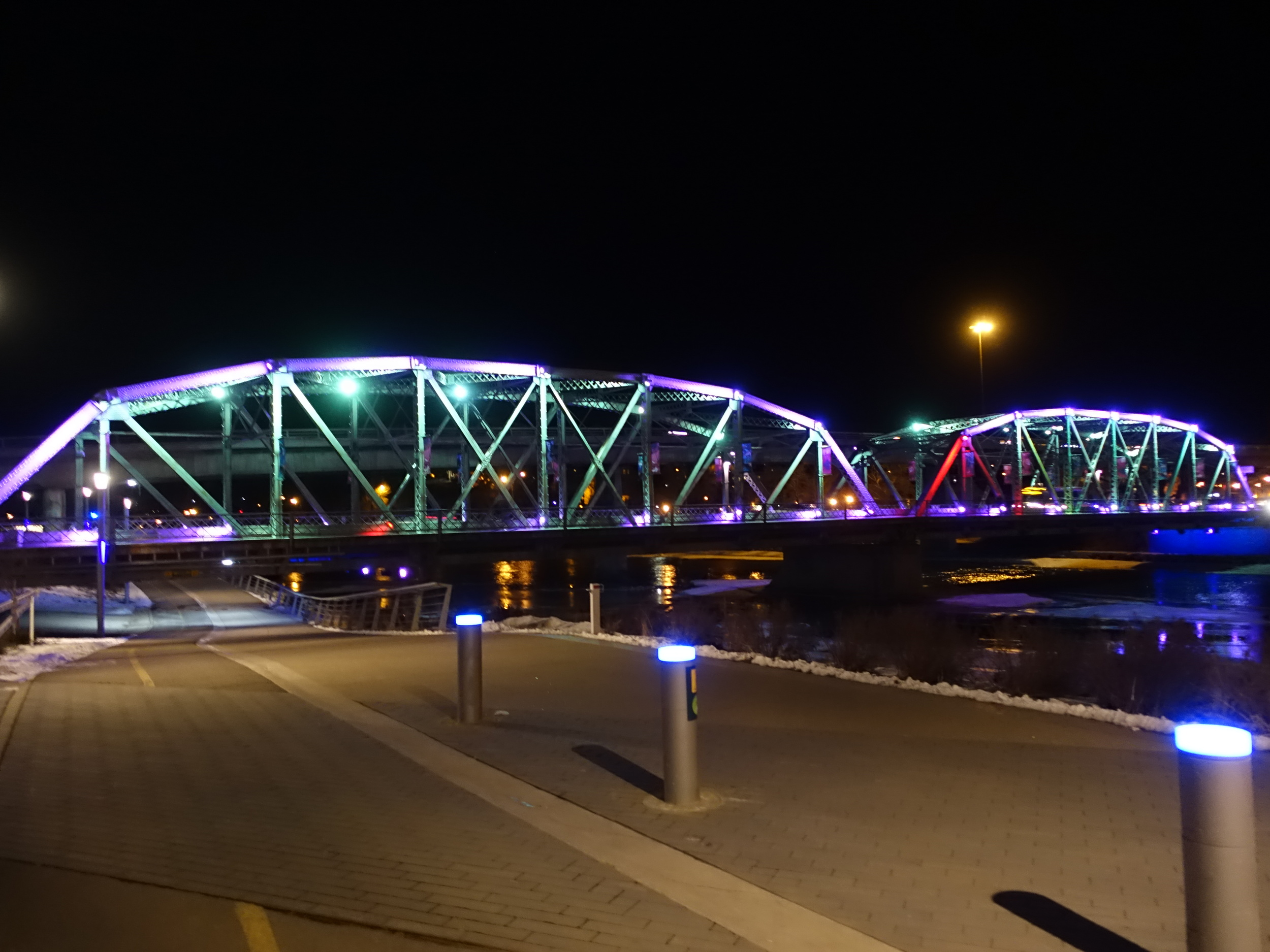 Langevin Bridge lights add colour at night to a dull grey bridge by day.