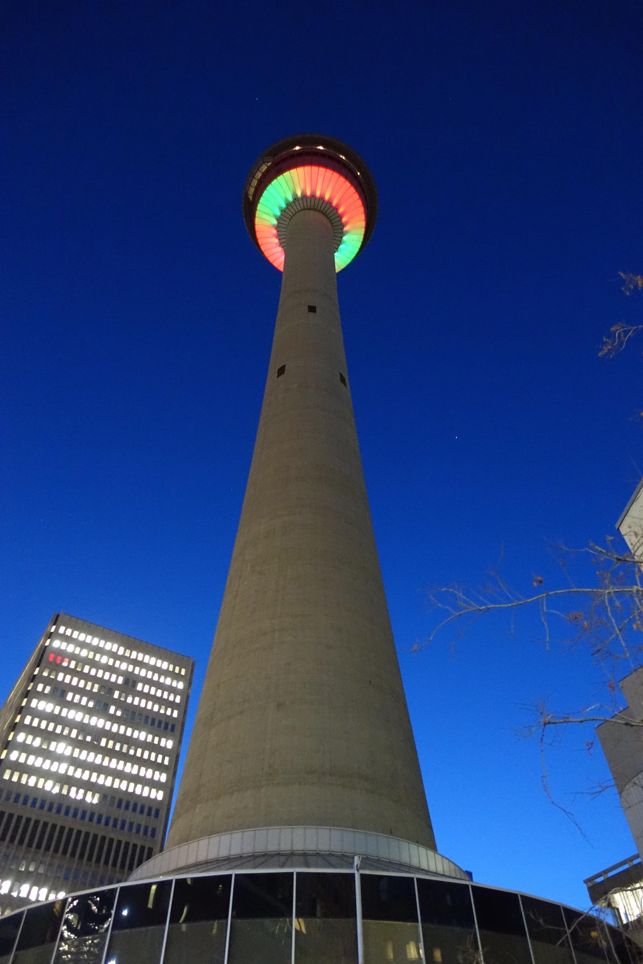 Calgary Tower revolving restaurant lighting at dawn.