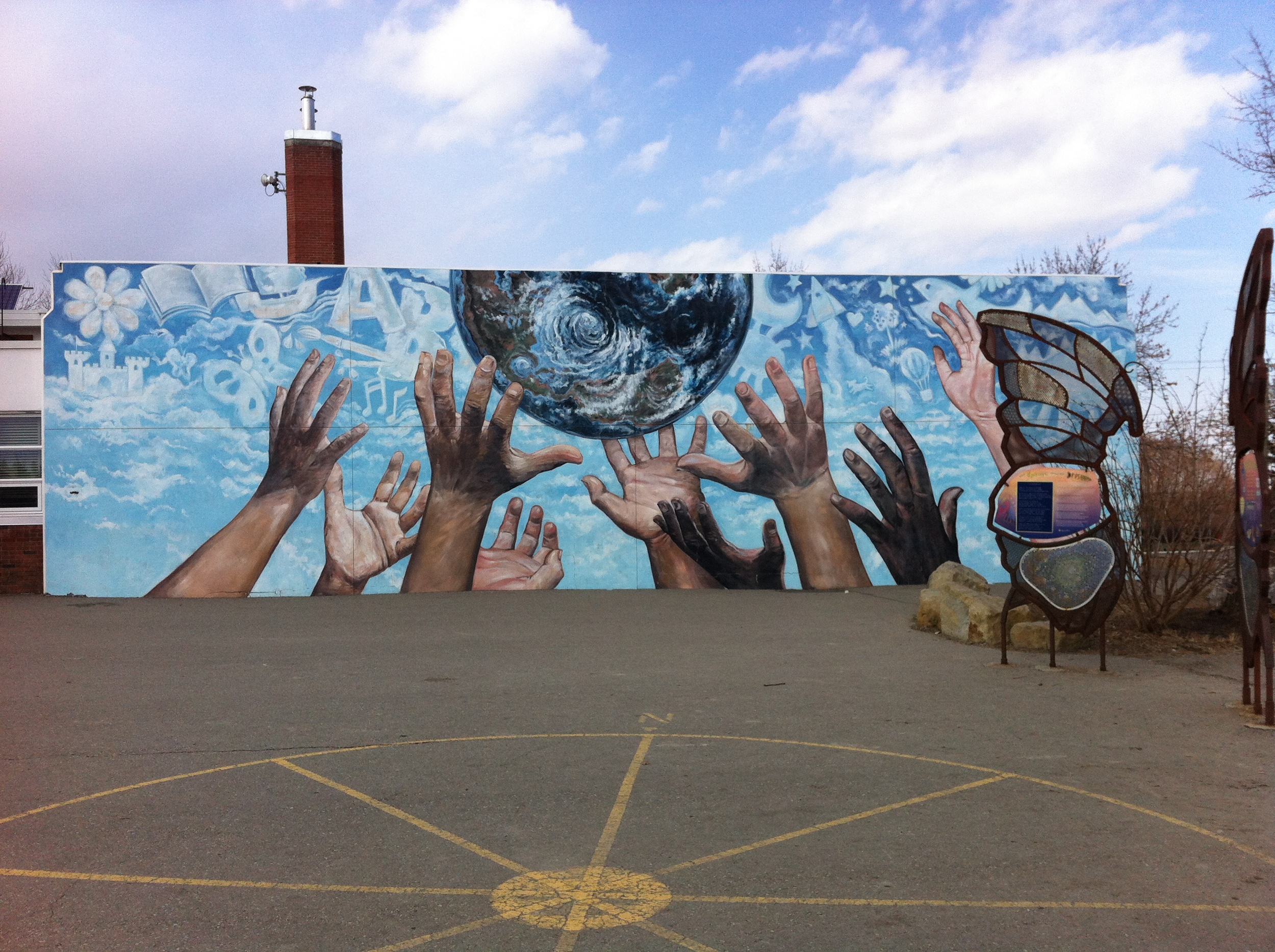 "Doug Driediger's 1998 mural ""The Promise"" in Alex Ferguson School yard is 18 feet by 60 feet."