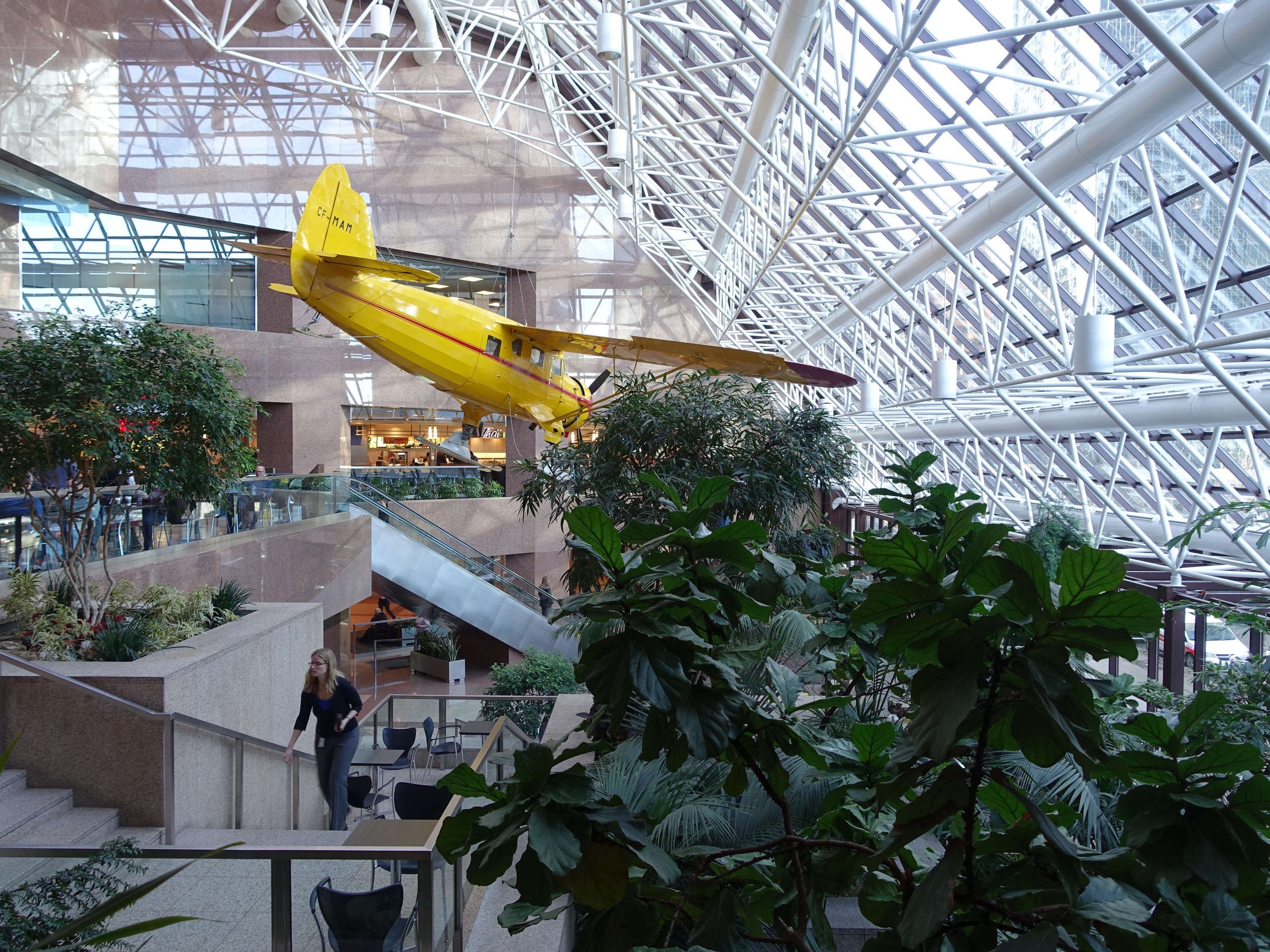 Bush plane suspended from the ceiling of Suncor Centre.
