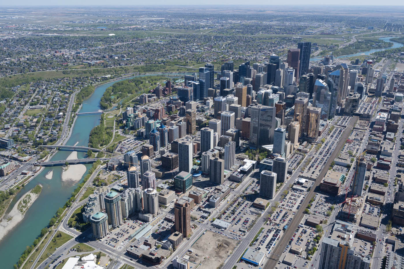 Downtown is an island of skyscrapers in a sea of low rise buildings. In this photo you can see how the Bow River divides the western half of the city into north and south quadrants. (photo credit Peak Aerials).