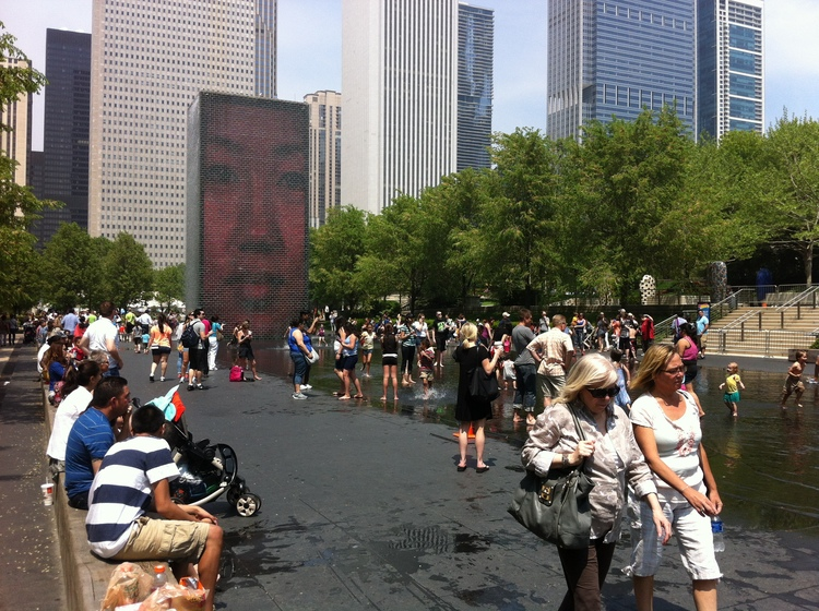 Crown Fountain with its wading pond attracts thousands of visitors a day to stop, watch and play, seven days a week, daytime and evening. I would have been nice to have an interactive artwork like this on St. Patrick's Island.