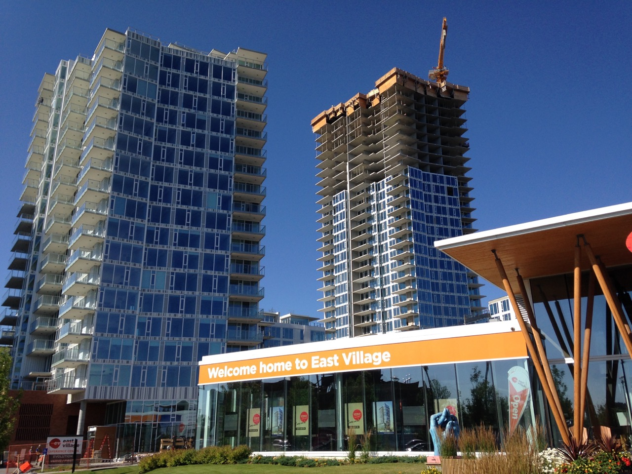 East Village sales pavilion, with new condos in the background.
