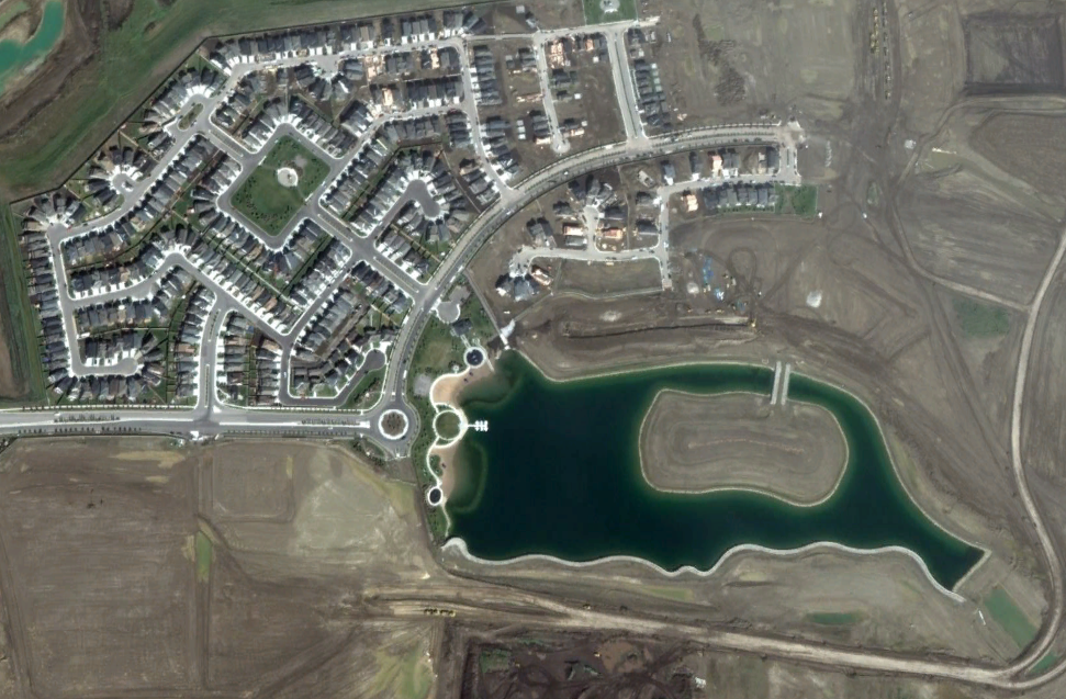 Google Earth image of the new Mahogany master planned community with its own lake and island.