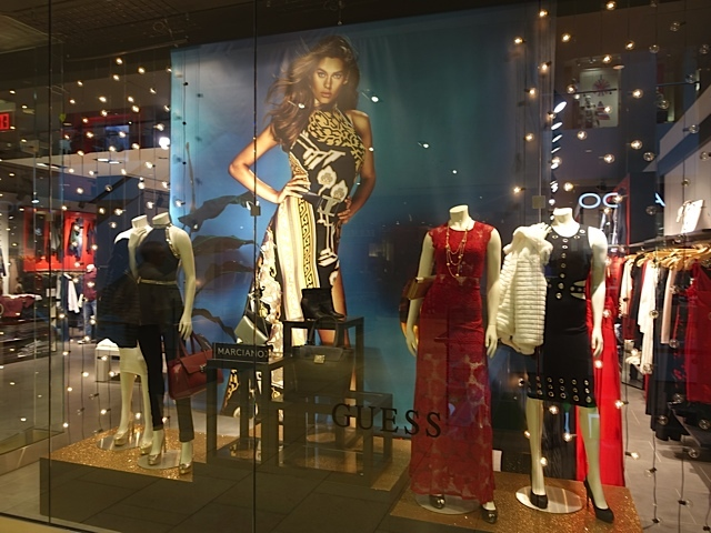 "Guess' window features their dresses but nothing says, ""This is Christmas..."""