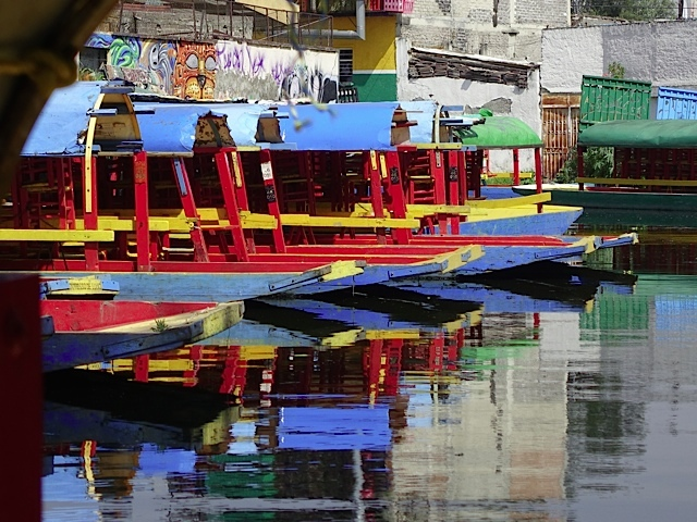 The picturesque dock area is jammed with colourful boats all painted pretty much the same.  They make wonderful reflections in the water.