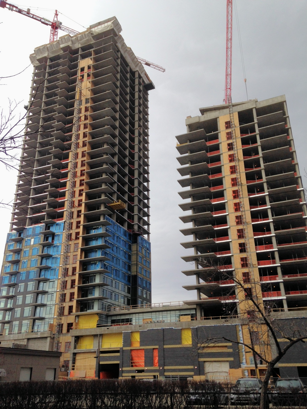 WAM's two unnamed rental apartment towers are rising up from where the luxury Astoria condo which was just capped off at ground level when it went bankrupt.