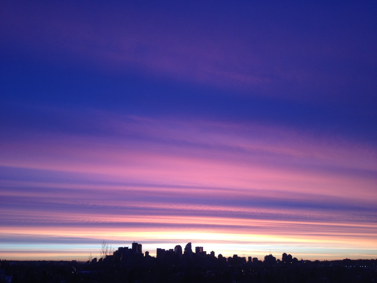 Morning sky over downtown Calgary, from St. Andrew's Heights