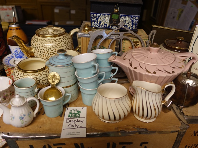 There is a small collection of vintage tea cups and pots.
