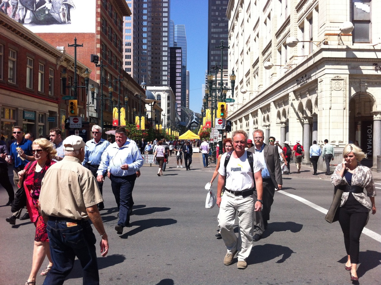 In the summer at noon hour, Stephen Avenue comes alive with downtown workers and a few tourists.