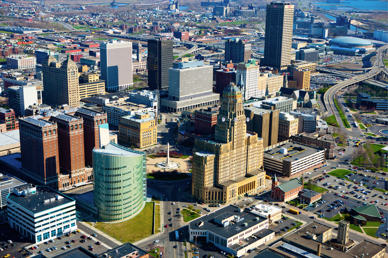 Aerial photo of downtown Buffalo, with Canalside and First Niagara Arena in the background