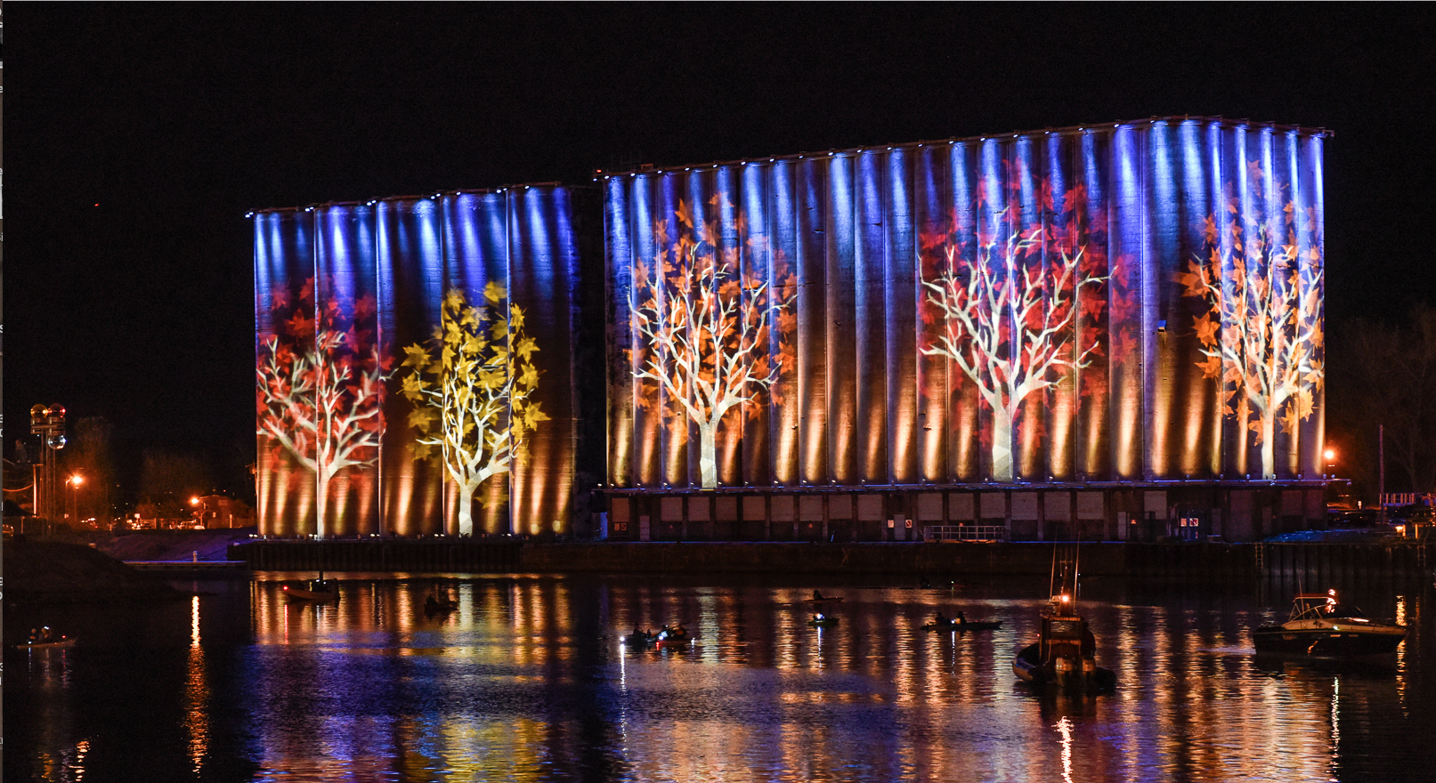 Buffalo's cement grain elevators have been turned into a unique screen for a nightly light show, that can be viewed from shore or by kayak. (photo credit: Joe Cascio)