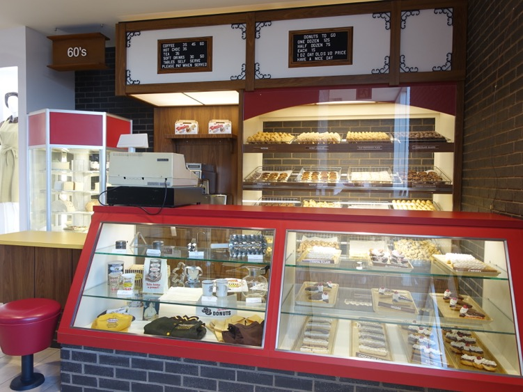 At the top of the stairs, you are welcomed by a replica Tim Horton counter with all of their iconic donuts.