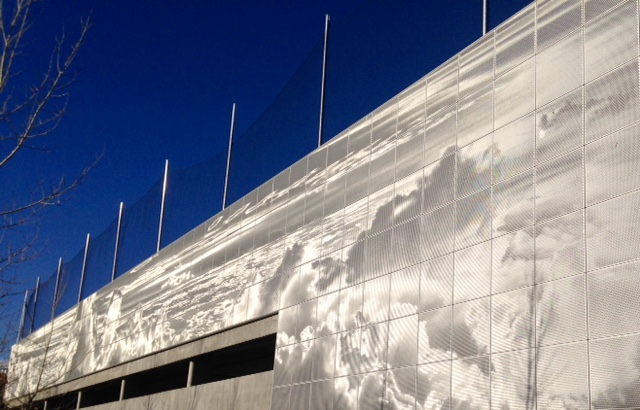 Close up of cloudscape mural from ground level.