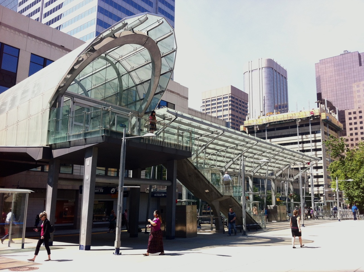 Calgary's 7th Avenue LRT station at Holt Renfew, opens to a lovely park that is popular with workers at noon hour.
