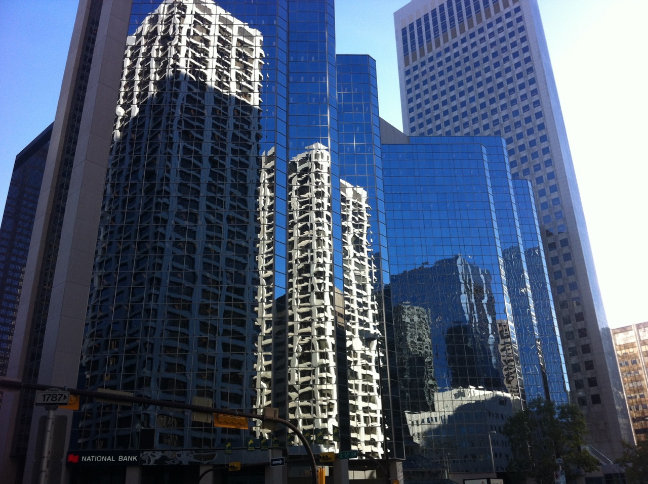 Another example of a street in Calgary's CBD that is just a wall of glass from office buildings.
