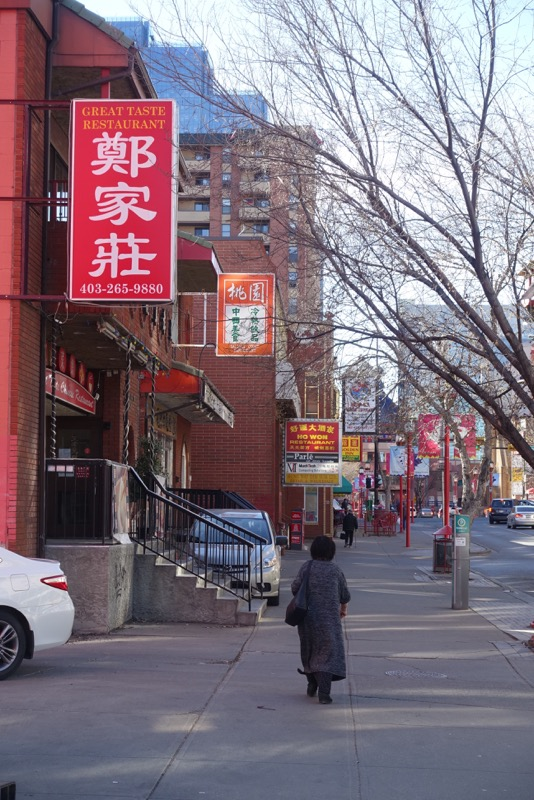 Chinatown's street vitality includes cars parked on the sidewalk, while street parking spots sit empty and only seniors on the sidewalks.
