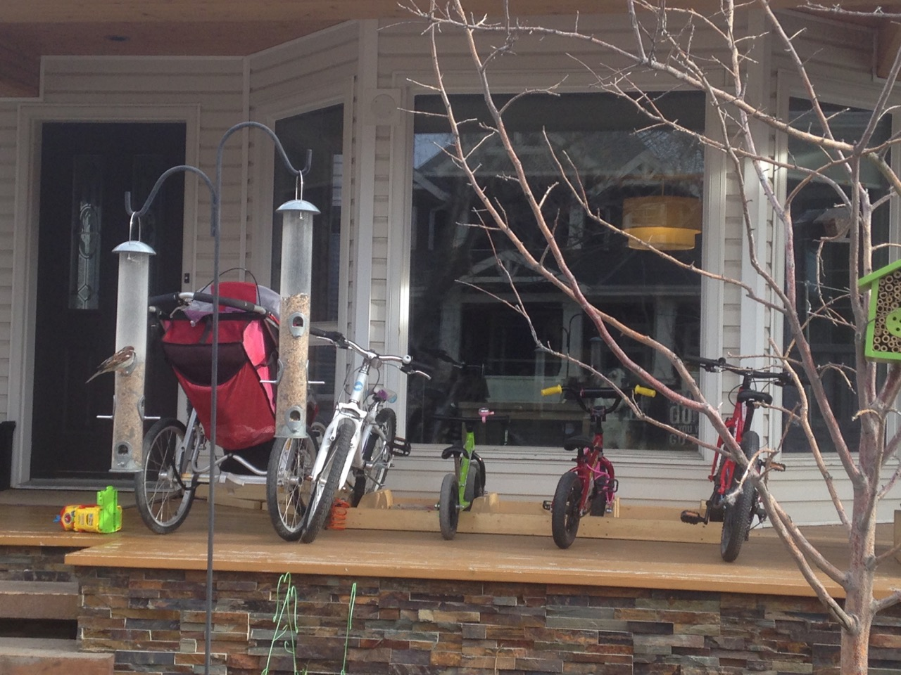 Also just a few blocks away is a house where the porch has become a bike rack. I love the fact that my community is filling up with young kids.