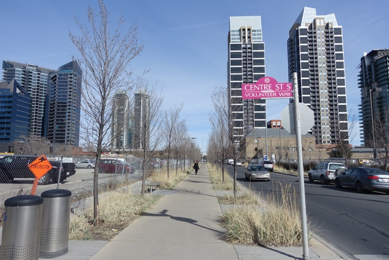 13th Avenue Greenway creates a promenade-like experience with wide sidewalk, trees and grasses in Calgary's Beltline community.