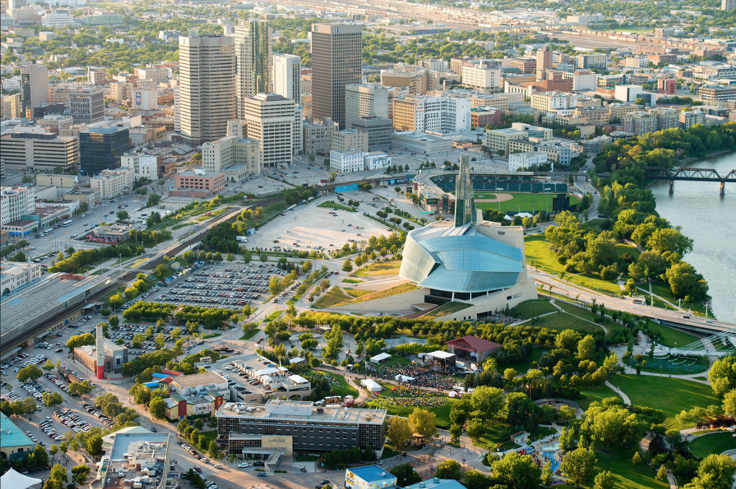 The Forks (where the Red and Assiniboine Rivers meet in Winnipeg) has been transformed into a mixed-use public space with two museums, baseball field, outdoor performance space, winter skating, market and hotel.