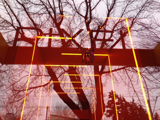 Pixel's entrance glass reflects the tree across the street to create an engaging entrance.