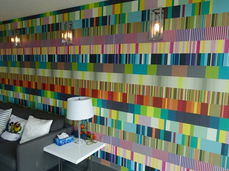 Lobby of 1741 condo by Truman Homes is playful and colourful.