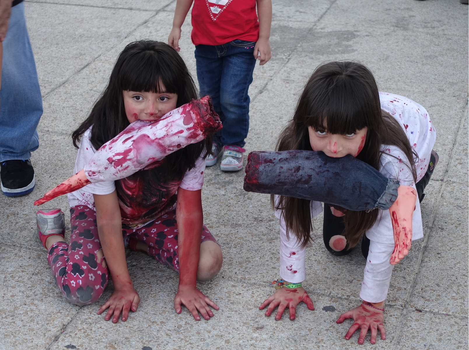 These two young girls were part of a Saturday afternoon Zombie walk in Mexico City that included many young children and very graphic costumes.  The amazing thing was that it was a fun family event with over 10,000 people of all ages having fun? These two girls with their parents permission willingly posed for this photo with big smiles.