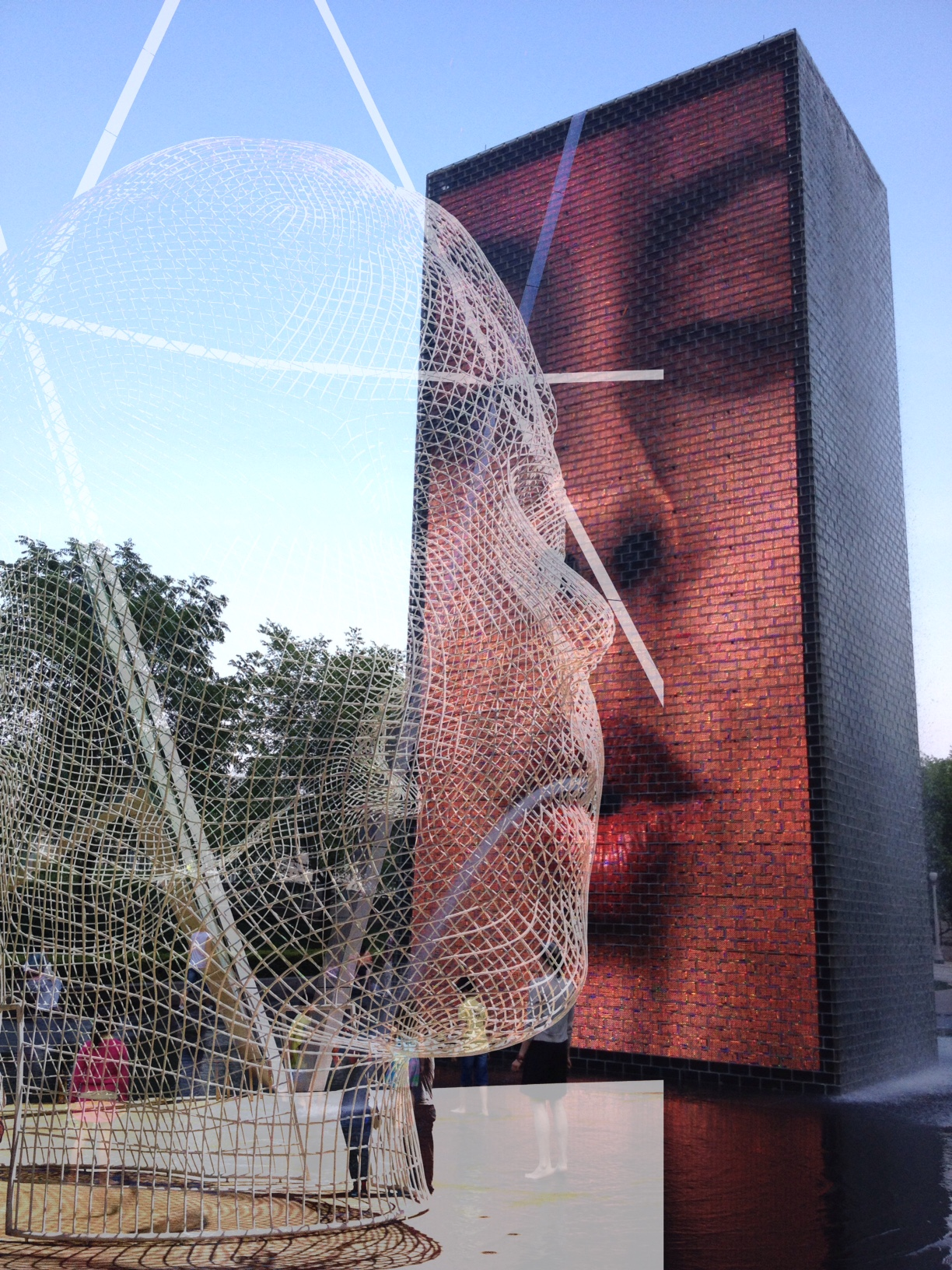 """Jaume Plensa's """"Crown Fountain"""" from Chicago's Millennium Park meets """"Wonderland"""" his public artwork on the plaza in front of Calgary's Bow Tower."""
